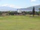 View from the 13th green at Maui Nui Golf Club, looking back down the fariway to Maalaea Bay