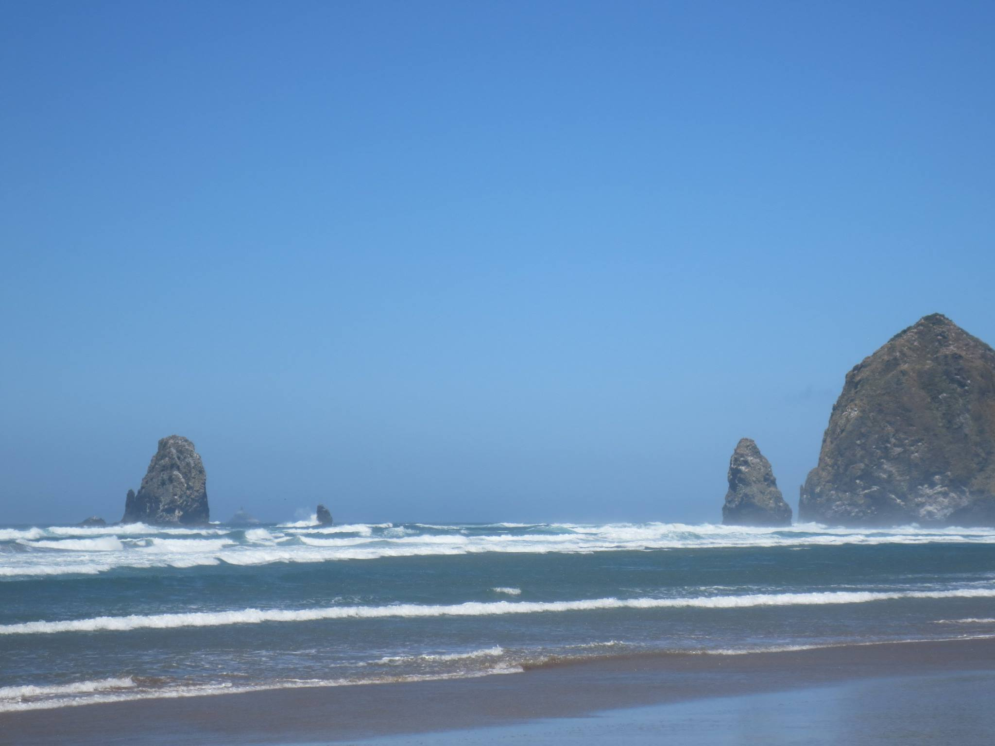 photo of the shoreline at Cannon Beach, featuring Haystack Rock